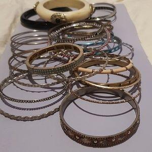 An Assortment of 30 Bangle Bracelets